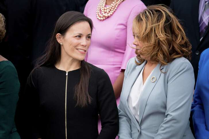 Lucy McBath, right, a Democrat from Georgia, speaks with Gina Ortiz Jones, a Democratic candidate from West Texas whose race remains undecided, during a group photo on Capitol Hill in Washington, Nov. 14, 2018. (Erin Schaff/The New York Times)