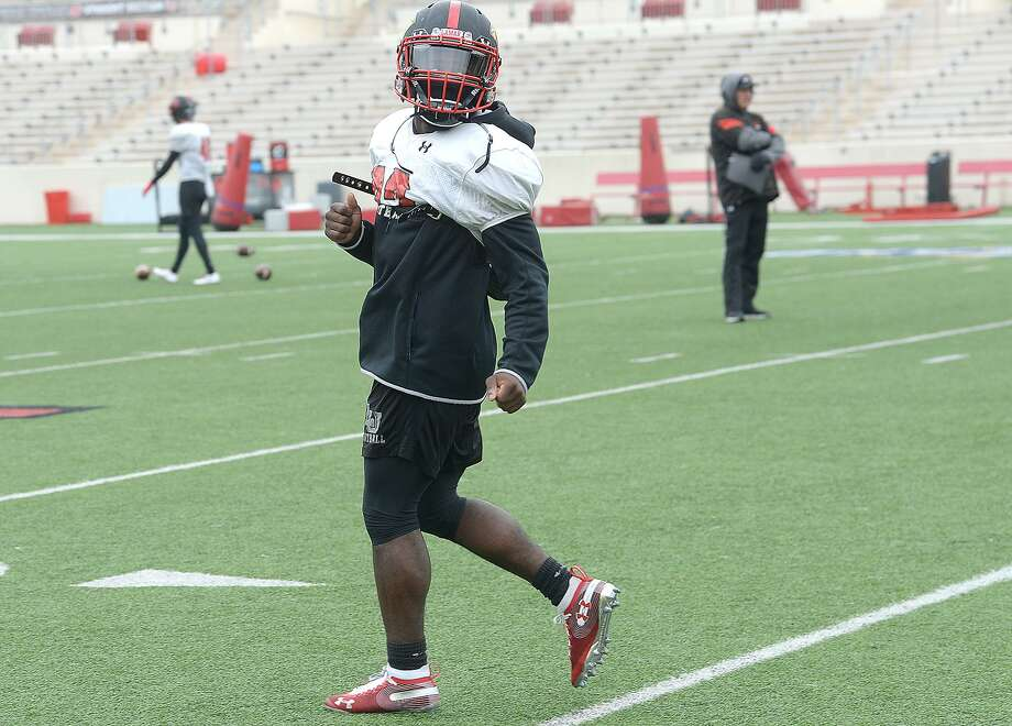 Lamar's Kirkland Banks runs plays as the Cardinals get in a cold day of practice and prepare for Saturday's game against rival McNeese.  Photo taken Tuesday, November 13, 2018  Kim Brent/The Enterprise Photo: Kim Brent / The Enterprise / BEN