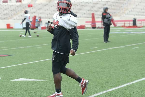 Lamar's Kirkland Banks runs plays as the Cardinals get in a cold day of practice and prepare for Saturday's game against rival McNeese. Photo taken Tuesday, November 13, 2018 Kim Brent/The Enterprise