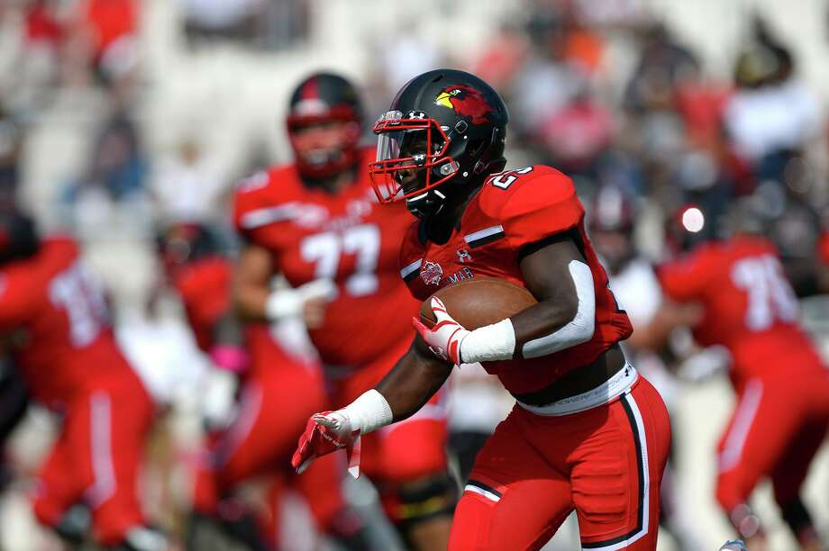 Lamar receiver 	Kirkland Banks carries the ball against Incarnate Word at Provost Umphrey Stadium on Saturday.   Photo taken Saturday 10/13/18  Ryan Pelham/The Enterprise Photo: Ryan Pelham / The Enterprise / ©2018 The Beaumont Enterprise