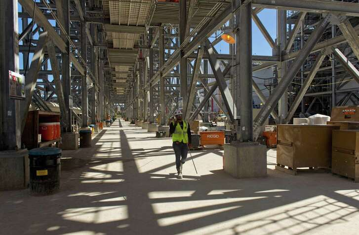 A contractor works during construction at the Cheniere Energy Inc. liquefied natural gas (LNG) export terminal in Corpus Christi, Texas/ on Wednesday, Oct. 3, 2018. Cheniere Energy said it started producing liquefied natural gas for the first time at the Corpus Christi plant.