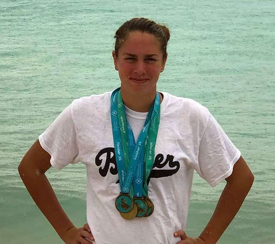 Old Greenwich resident and Greenwich Academy student Caroline Pennington garnered an impressive collection of medals after excelling at the Barbados Open Water Festival last weekend. Photo: Contributed Photo / Contributed Photo / Stamford Advocate Contributed