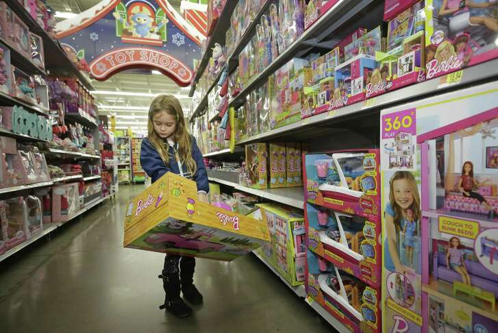 Eva Luna, 6, looks at a Barbie item at Walmart, 1118 Silber Rd., Monday, Nov. 12, 2018, in Houston.