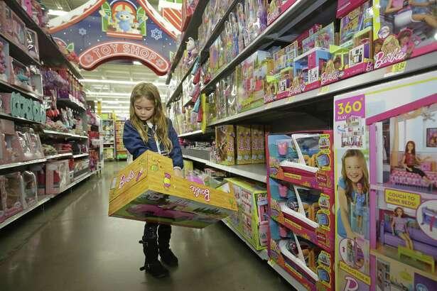 Eva Luna, 6, looks at a Barbie item at Walmart, 1118 Silber Rd., Monday, Nov. 12, 2018, in Houston.