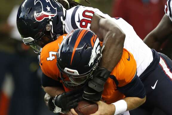 The Texans' Jadeveon Clowney (90) pounces on Broncos quarterback Case Keenum for one of his 5½ sacks this season.