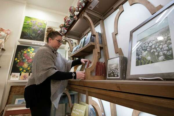 Kristin Lombard of Krilo Art prepares a display of her work on opening day of the Clinton Street Mercantile Thursday Nov. 15, 2018 in Schenectady, N.Y. (Skip Dickstein/Times Union)