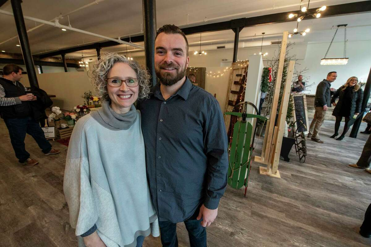 Brandon and Michelle Whittall pose for a photo on opening day of their new place, The Clinton Street Mercantile Thursday Nov. 15, 2018 in Schenectady, N.Y. (Skip Dickstein/Times Union)