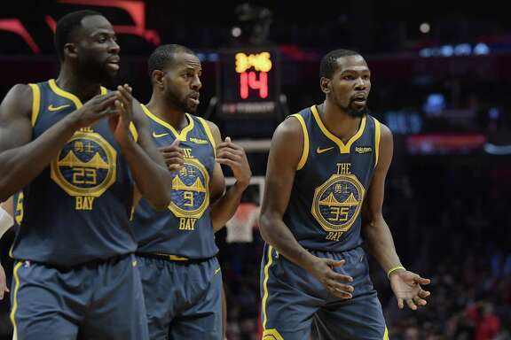 Golden State Warriors forward Kevin Durant, right, reacts as he fouls out of the game while forward Draymond Green, left, and guard Andre Iguodala look on during the overtime portion of an NBA basketball game against the Los Angeles Clippers Monday, Nov. 12, 2018, in Los Angeles. The Clippers won 121-116 in overtime. (AP Photo/Mark J. Terrill)