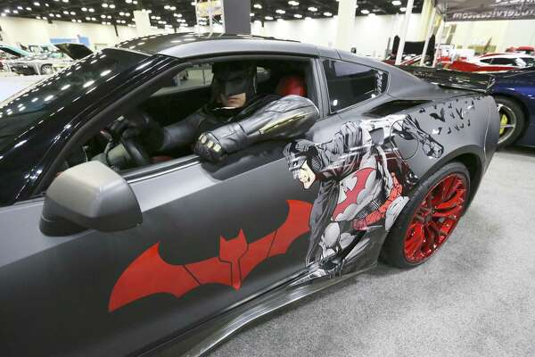 Batman of San Antonio is seen Thursday inside a specially designed Chevrolet Corvette known as the Batvette, which is used to give rides to children with illness such as cancer to their doctor's appointments at the 50th Annual San Antonio Auto & Truck Show.