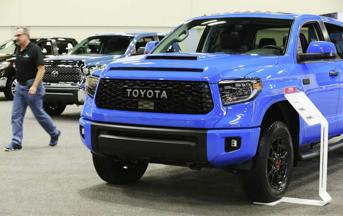 A row of Toyota Tundras is on display at the 50th Annual San Antonio Auto & Truck Show, which features the latest vehicles from domestic and import markets along with an exhibit of classic cars.