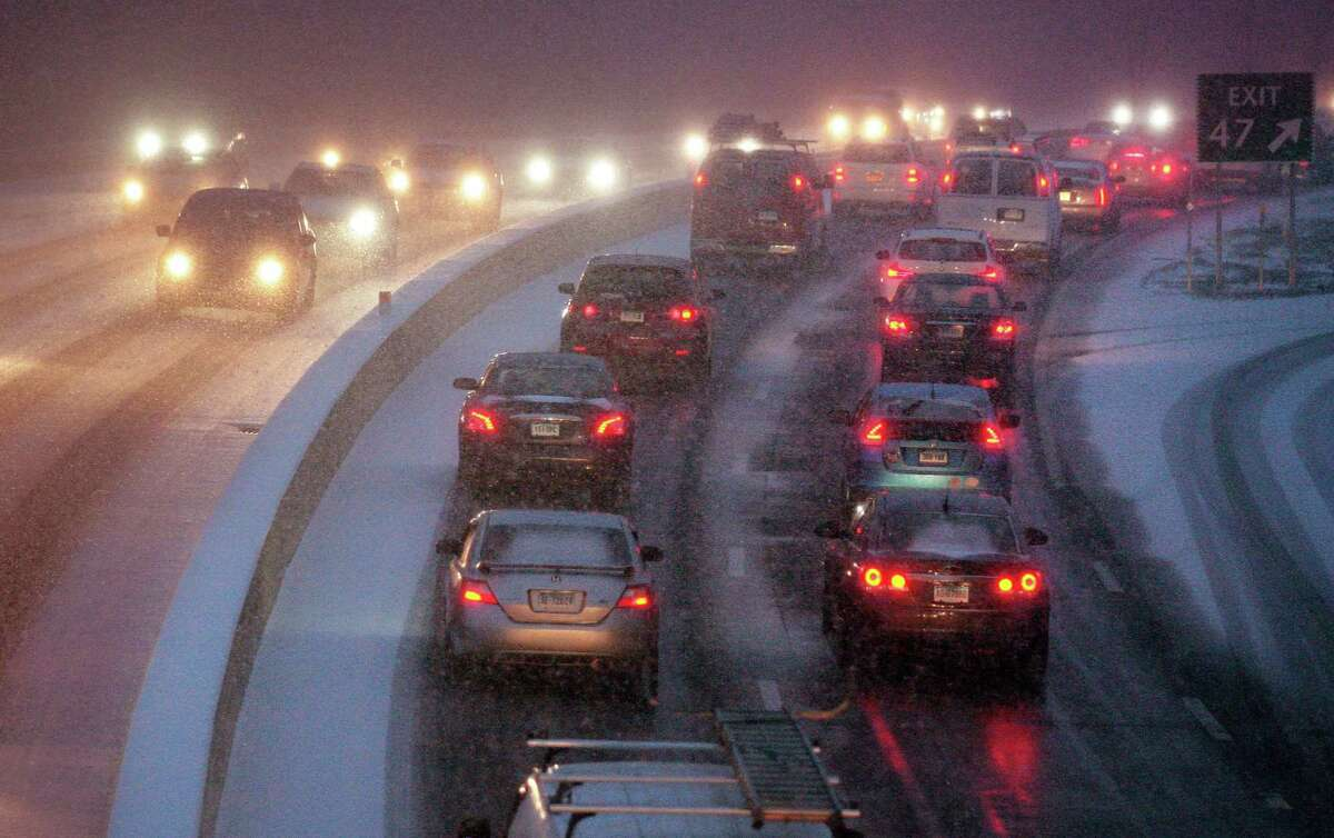 The first snowstorm of the season hits the region in Trumbull, Conn., on Thursday, Nov. 15, 2018. The snow which started falling in the later afternoon, caused headaches for many drivers around the area.