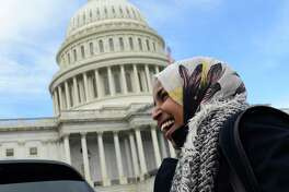 Rep.-elect Ilhan Omar, D-Minn., smiles during an interview following a photo opportunity on Capitol Hill in Washington, Wednesday, Nov. 14, 2018, with the freshman class.