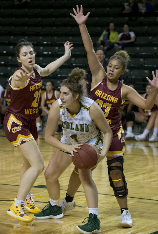 Midland College's Lana Marov looks to pass out from under the basket as Arizona Western's Rachel Obedin and Harria Mendoza defend 11/15/18 at the Chaparral Center. Tim Fischer/Reporter-Telegram Photo: Tim Fischer/Midland Reporter-Telegram