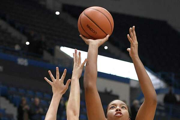 UConn's Megan Walker, right, shoots over Southern Connecticut State's Amanda Pfohl on Thursday night in Hartford.