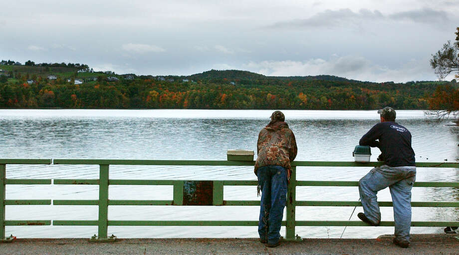 Jeff McCormack, left, and Tom Sweeney, of Guilderland, contemplate the fishing opportunities on the Tomhannock Reservoir from Route 115 in Pittstown. Sunday October 13, 2002. Photo: WILL WALDRON / ALBANY TIMES UNION