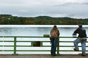 TIMES UNION STAFF PHOTO WILL WALDRON--RENTU--Jeff McCormack, left, and Tom Sweeney, of Guilderland, contemplate the fishing opportunities on the Tomhannock Reservoir from Route 115 in Pittstown. Sunday October 13, 2002.