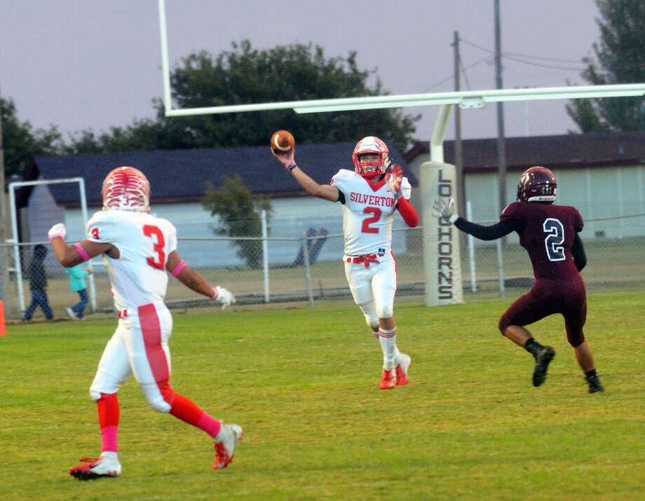 Silverton's Matthew Tiffin throws a pass to junior Daniel Colunga during the Owls' non-district football game against Hart on Oct. 5 in Hart. After the loss, the Owls rattled off three consecutive wins. Photo: Alexis Cubit/Plainview Herald