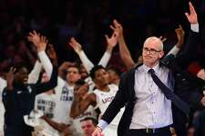 UConn coach Dan Hurley reacts as the bench celebrates after a Huskies rebound in the first half of Thursday's game against Syracuse in the 2k Empire Classic at Madison Square Garden in New York.