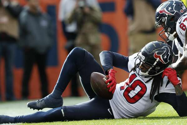 Houston Texans quarterback wide receivers DeAndre Hopkins (10) and Demaryius Thomas (87) celebrate Hopkins' 16-yard touchdown reception against the Denver Broncos during the second quarter of an NFL football game at Broncos Stadium at Mile High on Sunday, Nov. 4, 2018, in Denver.