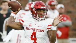 Houston quarterback D'Eriq King (4) throws during the first half of the team's NCAA college football game against SMU, Saturday, Nov. 3, 2018, in Dallas. (AP Photo/Brandon Wade)