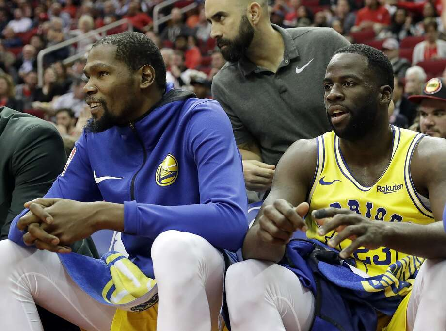Golden State Warriors' Kevin Durant, left, and Draymond Green sit on the bench during the first half of an NBA basketball game against the Houston Rockets Thursday, Nov. 15, 2018, in Houston. (AP Photo/David J. Phillip) Photo: David J. Phillip / Associated Press