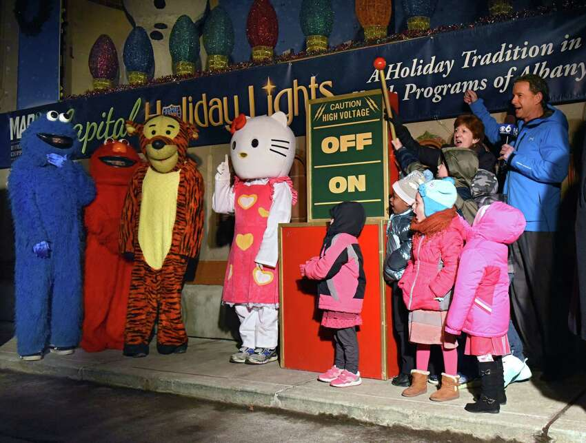Mayor Kathy Sheehan throws the switch to open the 22nd Annual Price Chopper/Market 32 Capital Holiday Lights in the Park in Washington Park on Thursday, Nov. 15, 2018 in Albany, N.Y. The Holiday Lights is produced by the Albany Police Athletic League. The drive-through begins nightly on Friday, November 23, 2018 through January 2, 2019. (Lori Van Buren/Times Union)