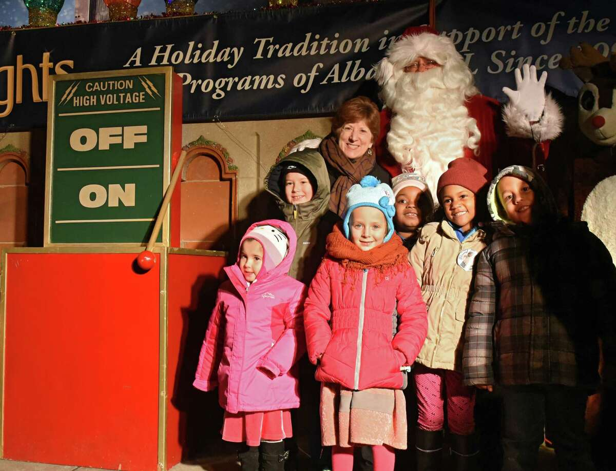 Children get their photo taken with Mayor Kathy Sheehan and Santa Claus after the mayor threw the switch to open the 22nd Annual Price Chopper/Market 32 Capital Holiday Lights in the Park in Washington Park on Thursday, Nov. 15, 2018 in Albany, N.Y. The Holiday Lights is produced by the Albany Police Athletic League. The drive-through begins nightly on Friday, November 23, 2018 through January 2, 2019. (Lori Van Buren/Times Union)
