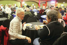 Pat Stewart, left, of Godfrey, and Rita Ford, of East Alton, talk while eating at Taste of Downtown, an annual fundraiser for Alton Main Street held Thursday in the Music Hall at the Argosy Casino Alton. About 400 people sampled everything from candies to crab cakes from 18 different restaurants, bars and others.