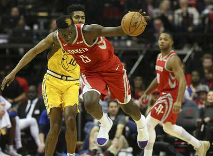 6aed63638661 Houston Rockets center Clint Capela (15) is fouled by Golden State Warriors  guard Jacob Evans (10) while both are going after a loose ball during the  second ...