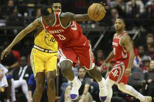 Houston Rockets center Clint Capela (15) is fouled by Golden State Warriors guard Jacob Evans (10) while both are going after a loose ball during the second quarter of the NBA game at Toyota Center on Thursday, Nov. 15, 2018, in Houston.