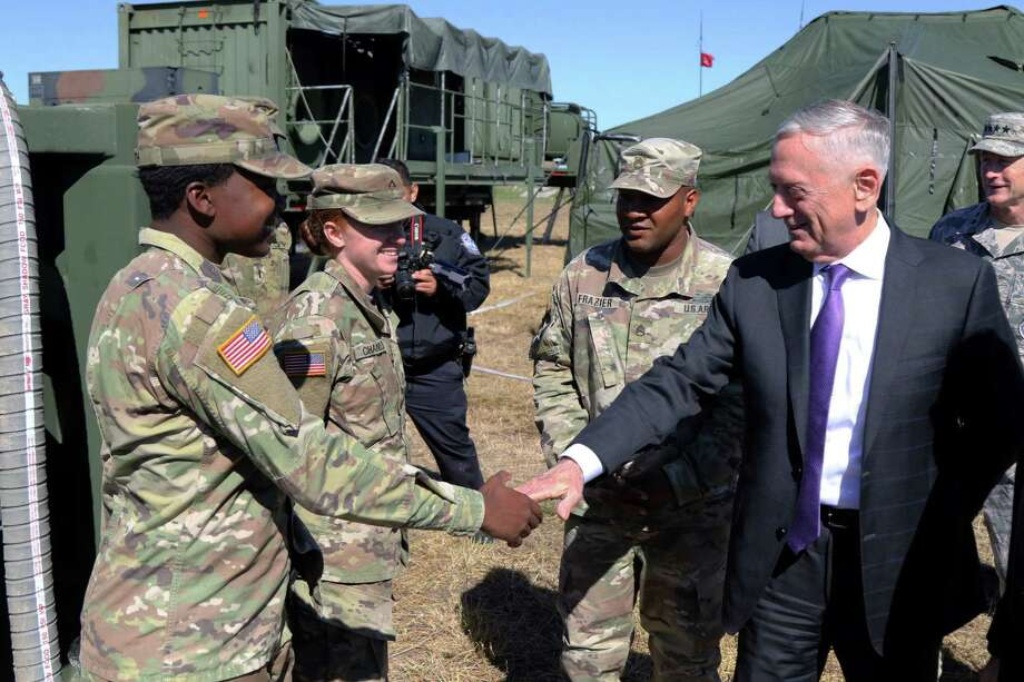 James Mattis, US Secretary of Defense, greets soldiers from the 289th Composite Supply Company at Base Camp Donna, Texas, on November 14, 2018. Photo: JACOB CALDWELL /AFP /Getty Images / Public Domain