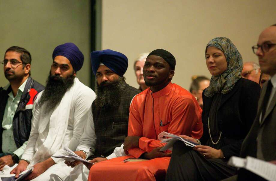 "Members of different faith traditions listen during the 34th Annual Houston Interfaith Thanksgiving Service at the Rothko Chapel in Houston, Thursday, Nov. 15, 2018. Leaders and members from myriad faith traditions including Baha'i, Buddhist, Christian, Hindu, Jain, Jewish, Muslim, Sikh, and Zoroastrian were invited to share prayer or reflection on the theme ""care for creation."" Photo: Mark Mulligan, Staff Photographer / © 2018 Mark Mulligan / Houston Chronicle"
