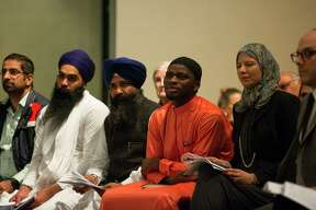 """Members of different faith traditions listen during the 34th Annual Houston Interfaith Thanksgiving Service at the Rothko Chapel in Houston, Thursday, Nov. 15, 2018. Leaders and members from myriad faith traditions including Baha'i, Buddhist, Christian, Hindu, Jain, Jewish, Muslim, Sikh, and Zoroastrian were invited to share prayer or reflection on the theme """"care for creation."""""""