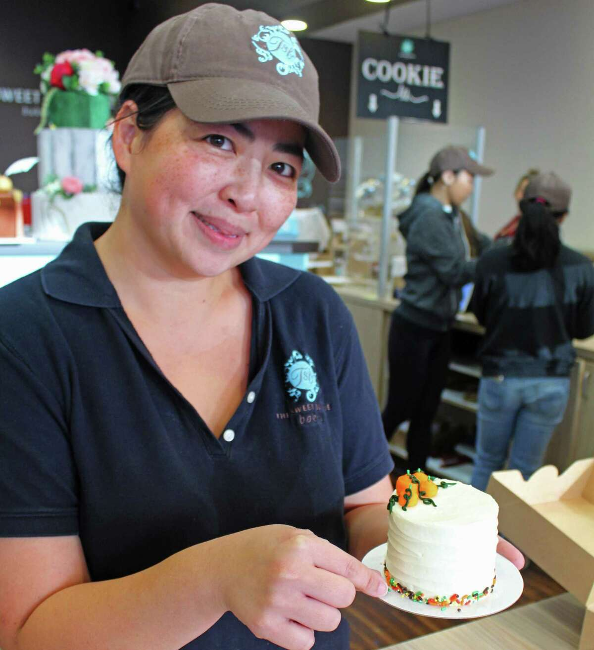 Christine Nguyen, owner of The Sweet Boutique, with one of their special holiday cakes.