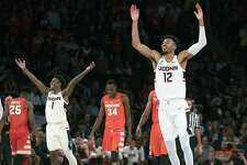 Connecticut forward Tyler Polley (12) and guard Christian Vital (1) react during the final minutes of the second half of an NCAA college basketball game against the Syracuse in the 2K Empire Classic, Thursday, Nov. 15, 2018, at Madison Square Garden in New York. Connecticut won 83-76. (AP Photo/Mary Altaffer)