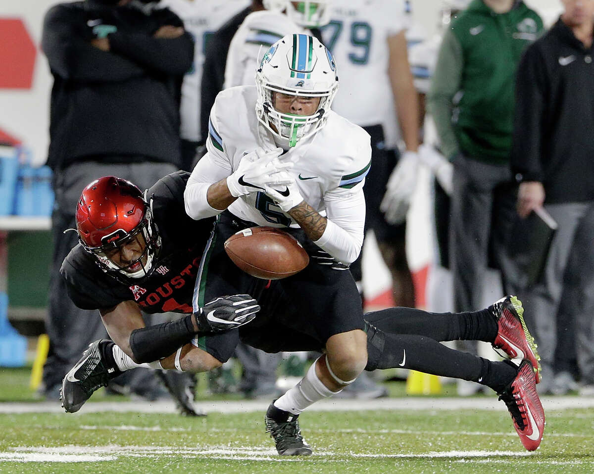 PHOTOS: New Era's official 2019 NFL Draft caps  Tulane wide receiver Terren Encalade (5) loses the reception under pressure from Houston cornerback Isaiah Johnson (14) during the first half of an NCAA college football game Thursday, Nov. 15, 2018, in Houston. (Michael Wyke/Houston Chronicle via AP) >>>See the caps that will be worn by players at the 2019 NFL Draft ...