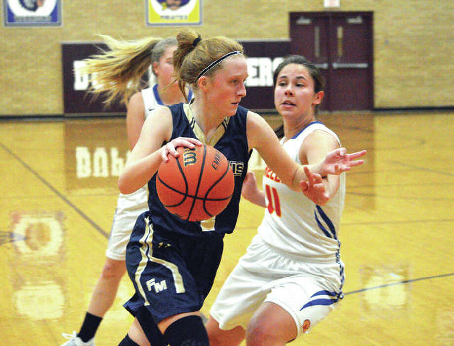 Father McGivney sophomore Anna McKee drives to the basket during the first quarter of Thursday's game against Roxana in the semifinals of the Dupo Cat Classic. Photo: Scott Marion/Intelligencer