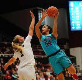 Cardinal forward Maya Dotson goes up for a shot over Dons guard Kia Vaalavirta. Stanford hit 15 of 32 three-point tries.