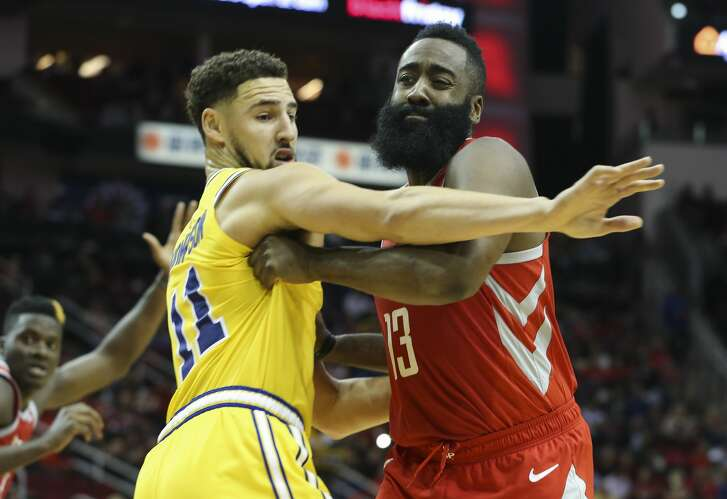 Houston Rockets guard James Harden (13) is defensed by Golden State Warriors guard Klay Thompson (11) during the second quarter of the NBA game at Toyota Center on Thursday, Nov. 15, 2018, in Houston.