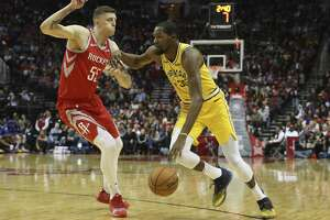 Houston Rockets forward Isaiah Hartenstein (55) defensing Golden State Warriors forward Kevin Durant (35) during the third quarter of the NBA game at Toyota Center on Thursday, Nov. 15, 2018, in Houston.