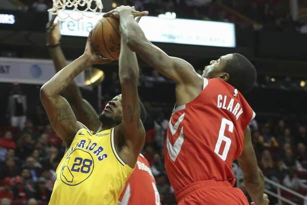 Houston Rockets forward Gary Clark (6) blocks Golden State Warriors forward Alfonzo McKinnie (28) during the fourth quarter of the NBA game at Toyota Center on Thursday, Nov. 15, 2018, in Houston. The Houston Rockets defeated the Golden State Warriors 107-86.