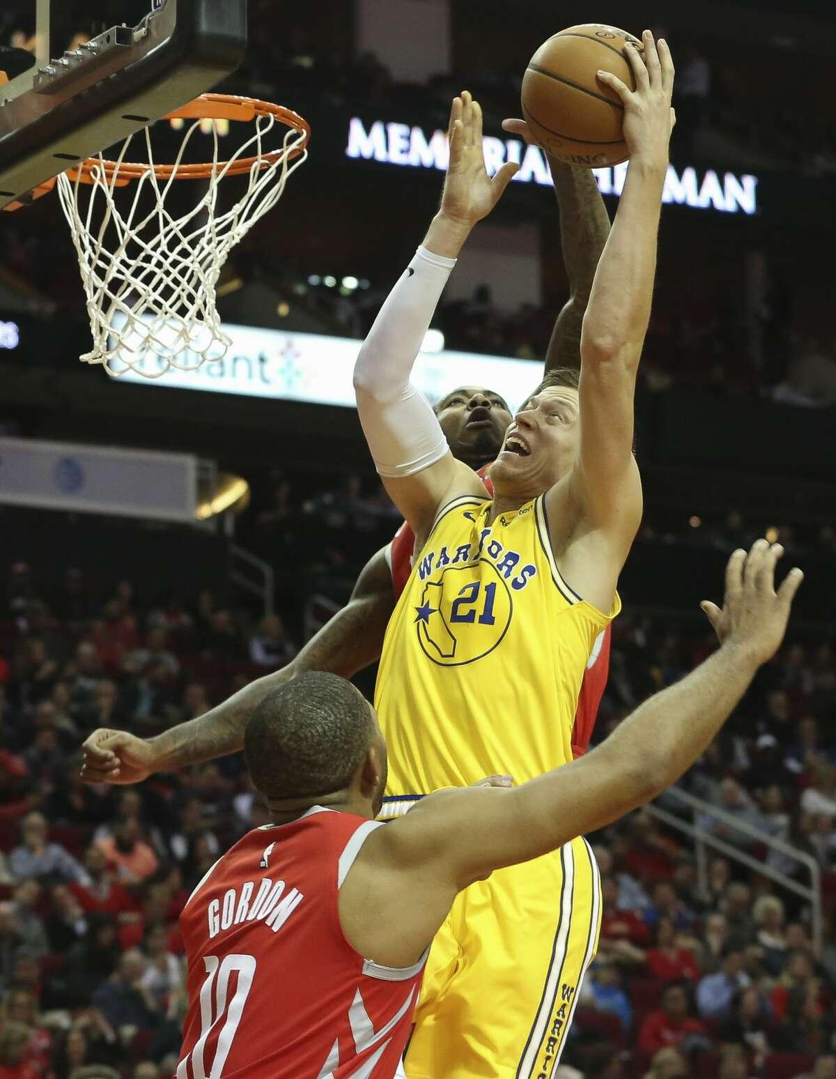 Houston Rockets forward Gary Clark (6) fouls on Golden State Warriors forward Jonas Jerebko (21) during the fourth quarter of the NBA game at Toyota Center on Thursday, Nov. 15, 2018, in Houston. The Houston Rockets defeated the Golden State Warriors 107-86.
