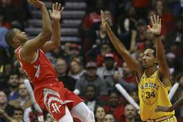 Houston Rockets guard Eric Gordon (10) aims for the basket while Golden State Warriors guard Shaun Livingston (34) is trying to stop him during the fourth quarter of the NBA game at Toyota Center on Thursday, Nov. 15, 2018, in Houston. The Houston Rockets defeated the Golden State Warriors 107-86.