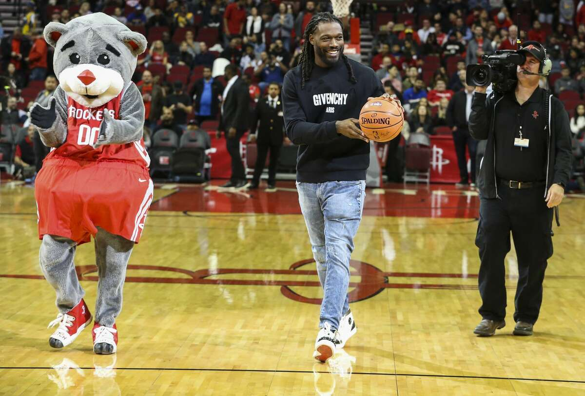 Houton Texans' Jadeveon Clowney performs the first-shot challenge before the NBA game between Houston Rockets and Golden State Warriors at Toyota Center on Thursday, Nov. 15, 2018, in Houston.