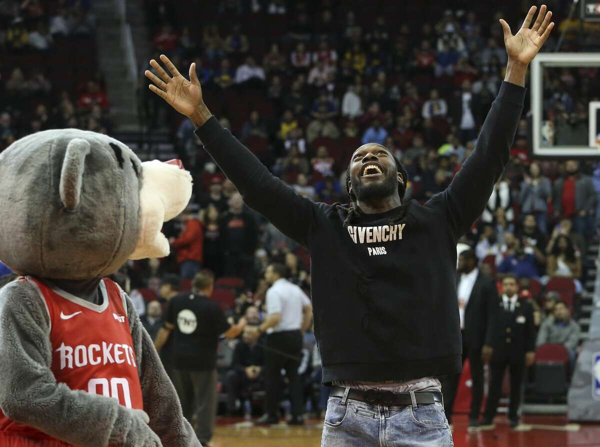 Houton Texans' Jadeveon Clowney reacts to his first-shot challenge before the NBA game between Houston Rockets and Golden State Warriors at Toyota Center on Thursday, Nov. 15, 2018, in Houston.