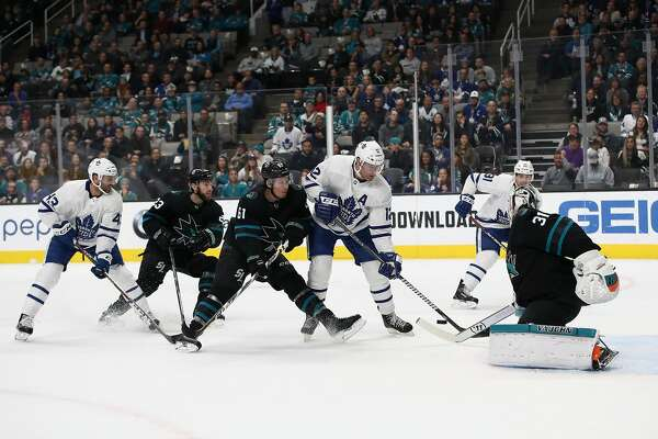 SAN JOSE, CA - NOVEMBER 15: Patrick Marleau #12 of the Toronto Maple Leafs tries to put a shot on goal against Justin Braun #61 and Martin Jones #31 of the San Jose Sharks at SAP Center on November 15, 2018 in San Jose, California. (Photo by Ezra Shaw/Getty Images)