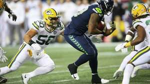 Seahawks running back Rashaad Penny runs the ball during the first half of Seattle's game against Green Bay, Thursday, Nov. 15, 2018, at CenturyLink Field.
