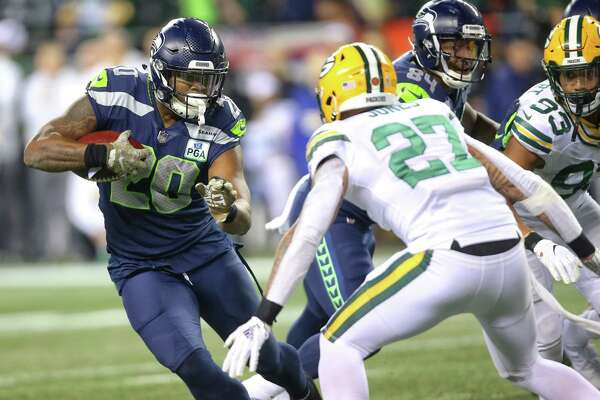 Seahawks running back Rashaad Penny picks up yards during the first half of Seattle's game against Green Bay, Thursday, Nov. 15, 2018, at CenturyLink Field.