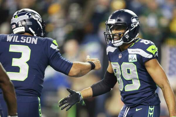 Seahawks quarterback Russell Wilson congratulates Seahawks wide receiver Doug Baldwin on his touchdown during the second quarter of Seattle's game against Green Bay, Thursday, Nov. 15, 2018, at CenturyLink Field.