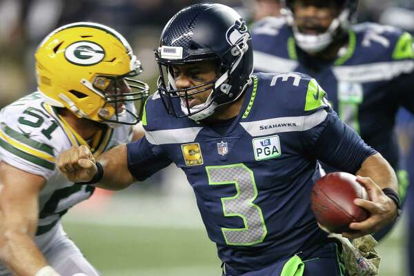 Seahawks quarterback Russell Wilson runs the ball during the third quarter of Seattle's game against Green Bay, Thursday, Nov. 15, 2018, at CenturyLink Field.